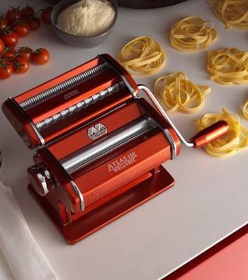 Red aluminum pasta machine Atlas on a table