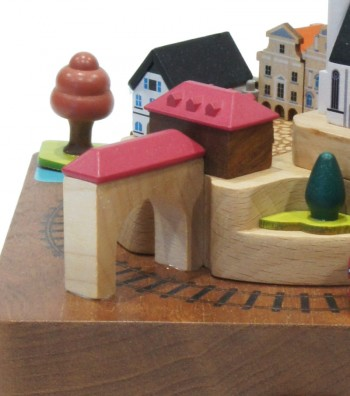 Wooden music box train and colorful houses